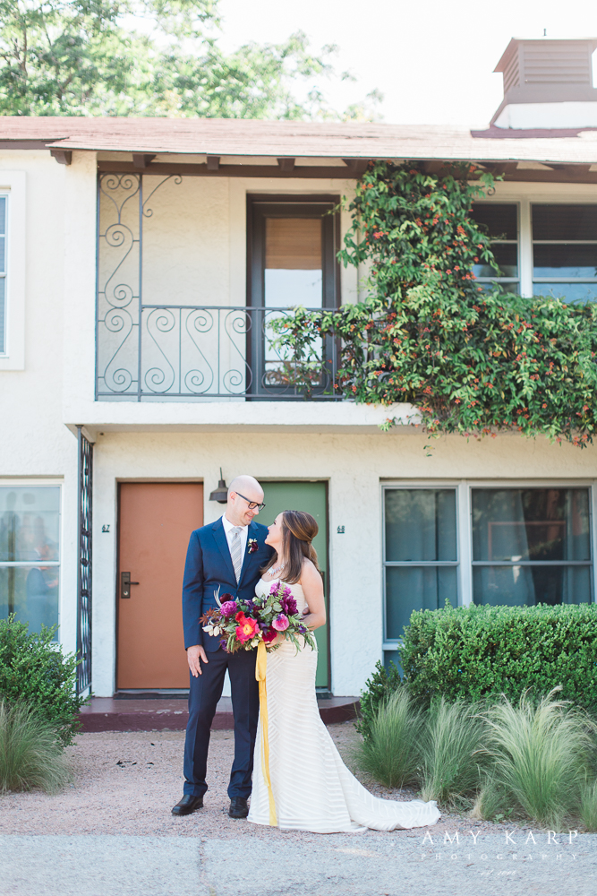 Bride and groom at their mid century modern hotel