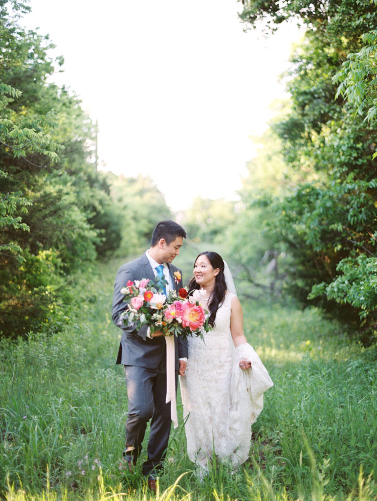 Bride and groom in a field after their wedding ceremony
