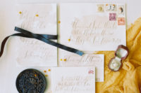 hand written wedding invitation styled with leather